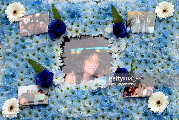A floral tribute with photographs of Meredith Kercher is shown at her funeral on December 14 2007 at Croydon Parish Church South London Three people...