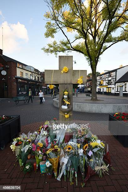 Floral tributes adorn the Eccles Cross for murdered aid worker Alan Henning in Eccles north west England on October 4 2014 Britain reacted with...