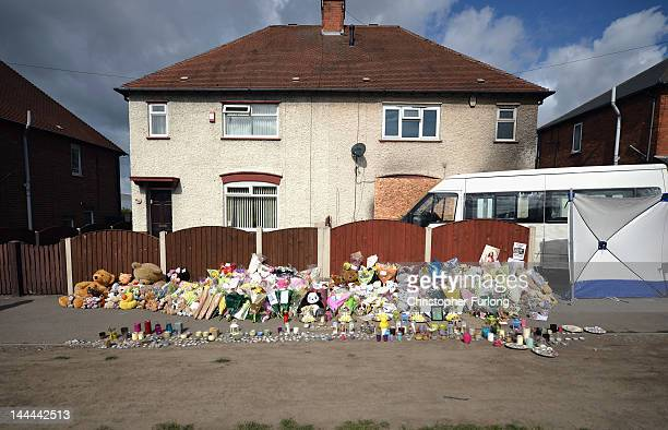 Floral tributes adorn the pavement outside a house in Allenton following the fire which claimed the lives of six children on May 14 2012 in Derby...