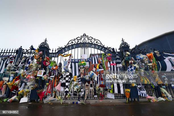 Floral tributes along with shirts and scarves left by West Bromwich Albion Fans in memory of Cyrille Regis on the Jeff Astle gates at The Hawthorns...