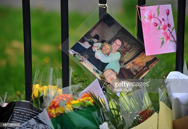 Floral tributes and a picture of murdered Spanish teacher Anne Maguire are left outside Corpus Christi Catholic College in Leeds, northern England,...
