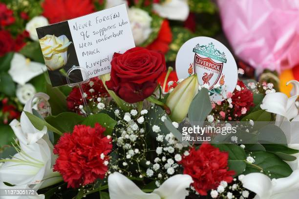 Floral tributes and balloons are pictured in front of the Hillsborough memorial outside of Liverpool Football Club's main stand at Anfield in...