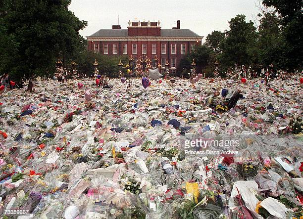 Floral tributes and balloons laid in the gardens of Kensington Palace after the death of Princess Diana Princess of Wales 31st August 1997