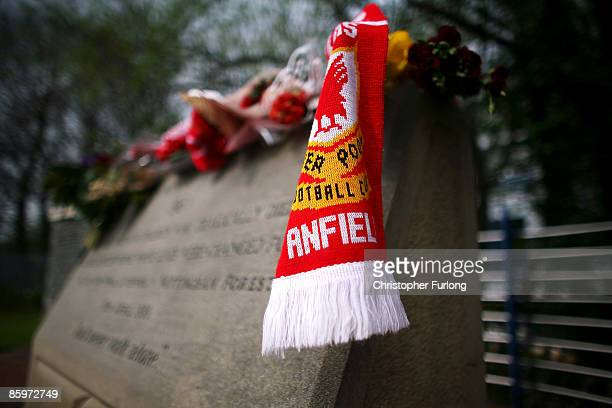 Floral tributes and Liverpool scarves lay in tribute on the Hillsborough disaster memorial at Sheffield Wednesday FC on the eve of the 20th...