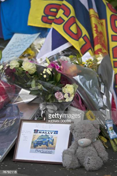 Floral tributes and memorabilia are placed at the entrance to the home of former world rally champion Colin McRae in Lanark in Scotland 17 September...