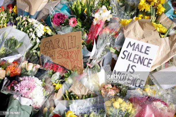 Floral tributes and messages in honour of Sarah Everard, the missing woman whose remains were found in woodland in Kent, are displayed at the...