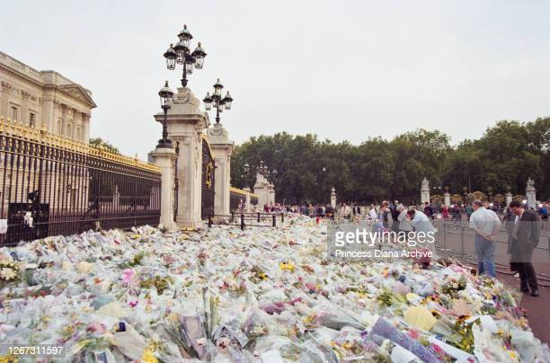 Floral tributes and messages of condolence in memory of British Royal Diana Princess of Wales are left outside Buckingham Palace in London England...