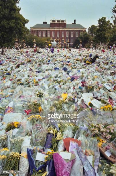 Floral tributes and messages of condolence in memory of British Royal Diana Princess of Wales are left outside Kensington Palace in London England...