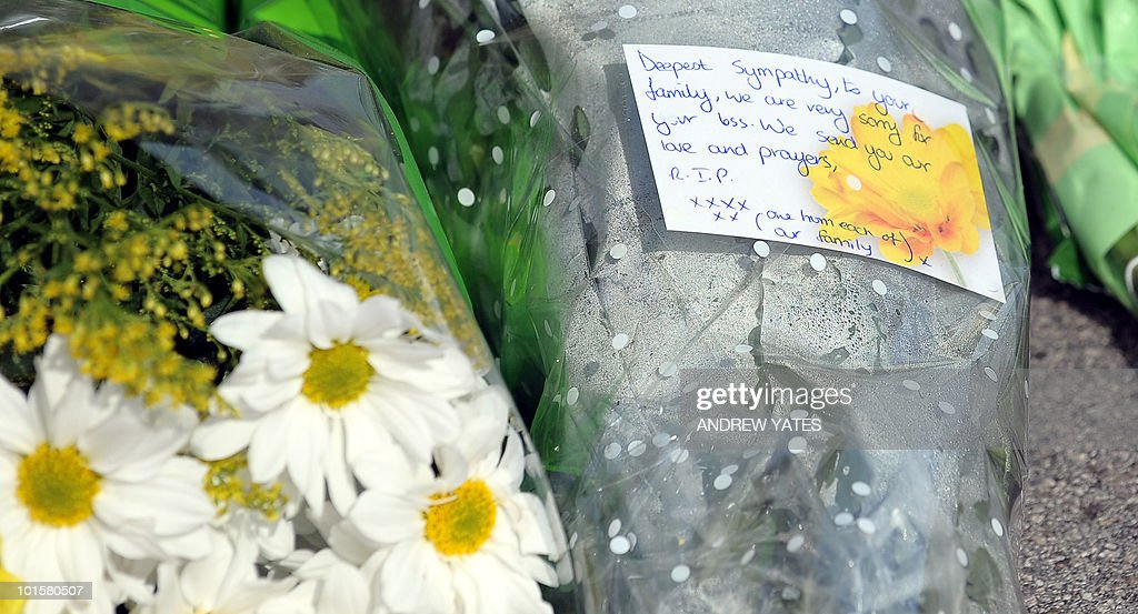 Floral tributes and written messages are left on a bridge on South Street in Egremont, Cumbria, on June 3, 2010, for a victim shot by lone gunman Derrick Bird on Wednesday. Friends and neighbours of Derrick Bird, who killed 12 people on a shooting spree in northern England, have expressed shock that a 'normal bloke' could wreak such devastation. But there were reportedly some prior warnings of the killings, which media reports suggest could have been caused by a family feud or a row at work -- and which caused the normally composed Bird to explode.