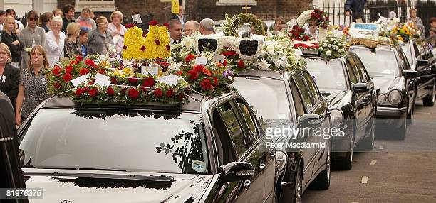 Floral tributes are displayed on the cortege for the funeral of 16 year old Ben Kinsella on July 18 2008 in Islington London England Kinsella was the...