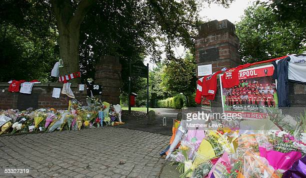 Floral tributes are laid at the scene where 18yearold Anthony Walker died by McGoldrick Park Huyton on August 5 2005 in Merseyside England Walker...