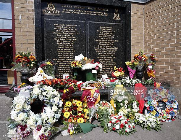 Floral tributes are laid at the Valley Parade Fire Memorial on the thirtieth anniversary of the Valley Parade fire during the Sky Bet League One...