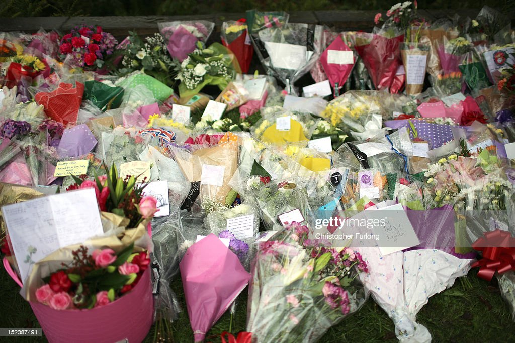 Floral tributes are laid by wellwishers at the scene of the shooting of WPCs Nicola Hughes and Fiona Bone in Hattersley on September 20, 2012 in Manchester, England. Local man Dale Cregan, 29, has been arrested in connection with the shooting of WPCs Nicola Hughes and Fiona Bone, who suffered fatal injuries in a gun and grenade attack in Mottram, during a routine call to investigate a burglary in Abbey Gardens on Tuesday.