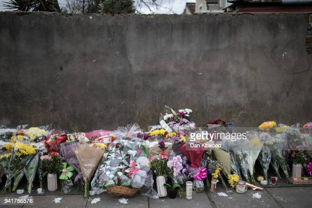 Floral tributes are left at the scene where a 17 year old girl was shot and killed in Northumberland Park on April 4 2018 in London England Tanesha...