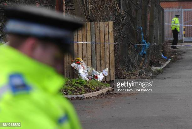 Floral tributes are left close to the house in Wakefield where ArchieLee Hirst was killed by a dog