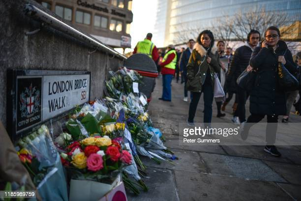 Floral tributes are left for Jack Merritt and Saskia Jones who were killed in a terror attack on December 2 2019 in London England Usman Khan a 28...