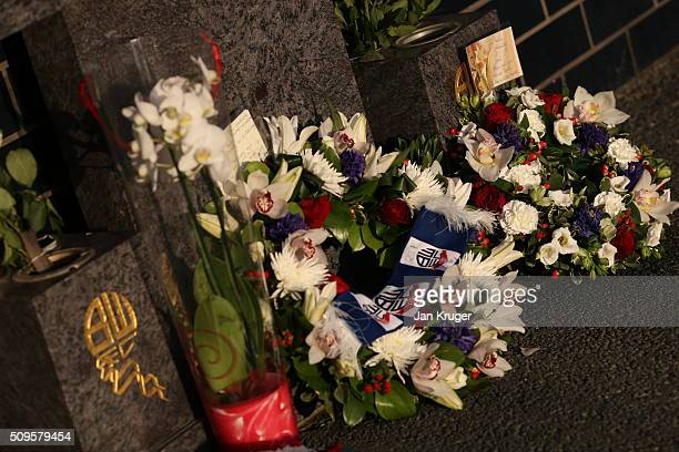 Floral tributes are left in memory of former Bolton Wanderers Chairman Phil Gartside is placed at Macron Stadium on February 11 2016 in Bolton England