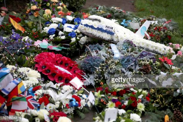 TOPSHOT Floral tributes are pictured at a service to mark the 30th anniversary of the Lockerbie Air Disaster the 1988 bombing of Pan Am flight 103...