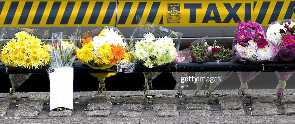 Floral tributes are pictured at a taxi rank on Duke Street in Whitehaven, Cumbria, north-west England, on June 3, 2010, after three people were shot at the rank by gunman Derrick Bird Wednesday. Friends and neighbours of Derrick Bird, who killed 12 people on a shooting spree in northern England, have expressed shock that a 'normal bloke' could wreak such devastation. But there were reportedly some prior warnings of the killings, which media reports suggest could have been caused by a family feud or a row at work -- and which caused the normally composed Bird to explode. AFP PHOTO/Derek Blair