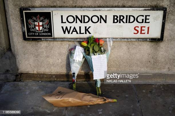 Floral tributes are pictured close to London Bridge in the City of London on November 30 following the November 29 terror incident in which two...