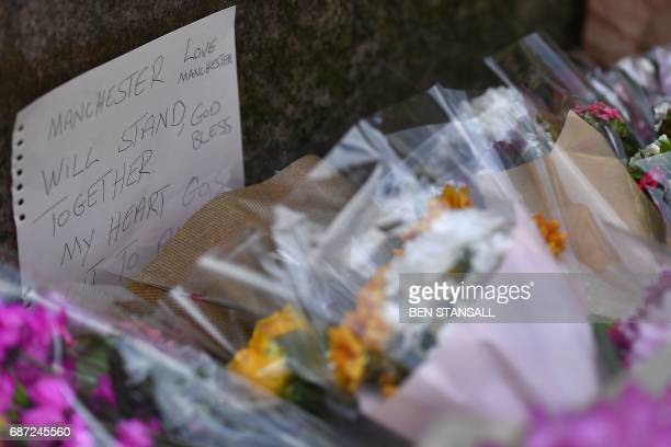 Floral tributes are pictured in St Ann's Square in Manchester northwest England on May 23 laid as a mark of respect to those in killed and injured...