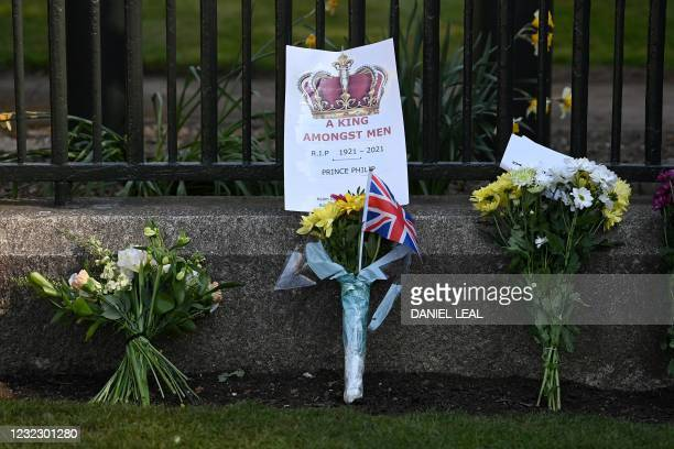 Floral tributes are pictured outside Windsor Castle in Windsor, west of London, on April 14 following the April 9 death of Britain's Prince Philip,...