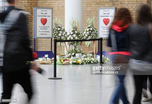 TOPSHOT Floral tributes are placed at Manchester Victoria railway station on May 30 2017 in Manchester A train station next to the scene of last...