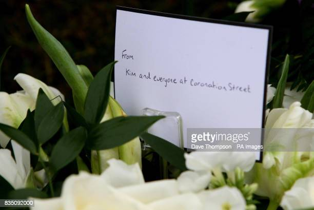 Floral tributes are seen at a memorial service for Sara Roache, the wife of Coronation Street actor Bill, at St Bartholomew's Church, Wilmslow,...