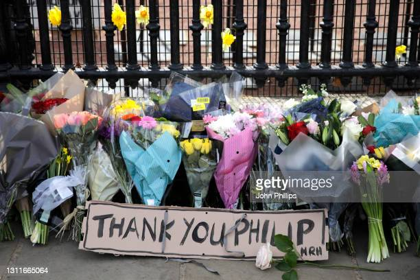 Floral tributes are seen outside Buckingham Palace on April 09, 2021 in London, United Kingdom. The Queen has announced the death of her beloved...