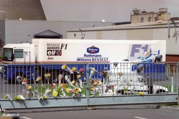 Floral tributes at the gate of the WilliamsRenault headquarters at Didcot Oxfordshire after the death of Williams Formula One driver Ayrton Senna