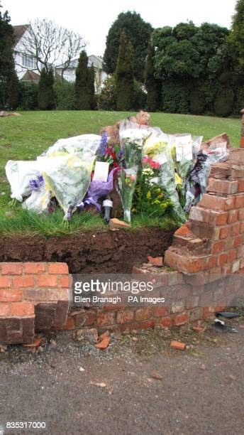 Floral tributes at the scene on the A449 in Wombourne near Wolverhampton where three people died after the car they were in ploughed into a wall as...