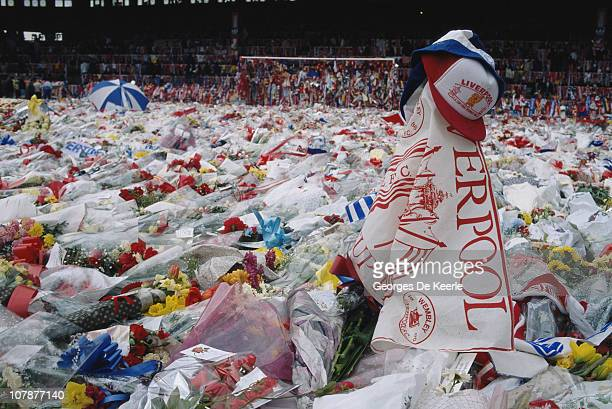 Floral tributes cover the pitch at Anfield Liverpool during a memorial ceremony held after the Hillsborough disaster in which 96 Liverpool fans were...