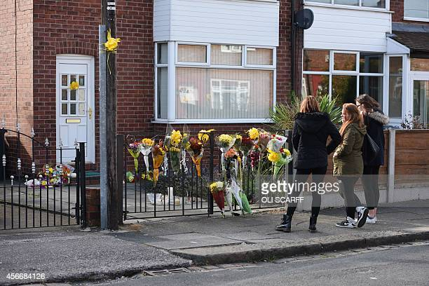 Floral tributes for murdered aid worker Alan Henning are placed outside his home in Eccles north west England on October 5 2014 Britain united in...