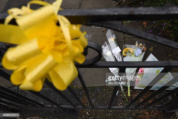 Floral tributes for murdered aid worker Alan Henning lie outside his home in Eccles north west England on October 4 2014 Britain reacted with horror...