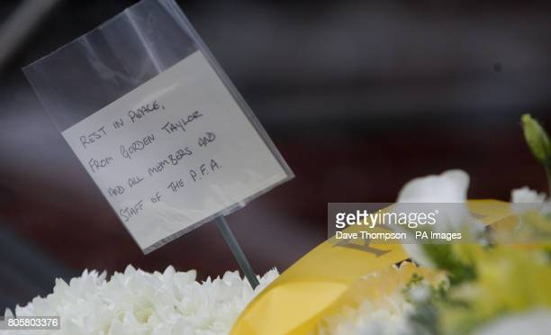 Floral tributes from the PFA inside the hearse of Busby Babe Albert Scanlon as it arrives at All Souls Church in the Weaste area of Salford