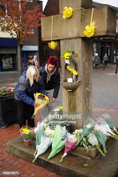 Floral tributes in memory of murdered aid worker Alan Henning are placed on a monument known as the Eccles Cross on October 4 2014 in Salford England...
