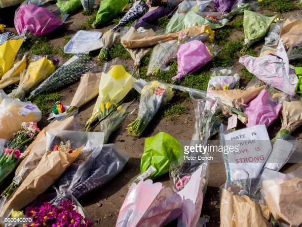 Floral tributes in Parliament Square Garden for victims of the terror attack in Westminster on the 22nd March Several people died and at least 40...