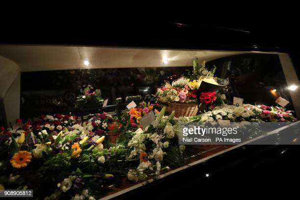 Floral tributes in the hearse as the the coffin of The Cranberries singer Dolores O'Riordan is taken into Saint Ailbe's Church Ballybricken ahead of...