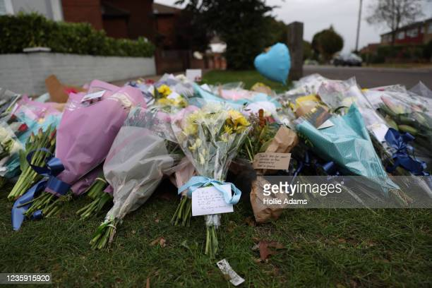 Floral tributes laid near Belfairs Methodist Church on October 16, 2021 in Leigh-on-Sea, United Kingdom. Counter-terrorism officers are investigating...
