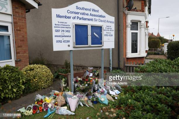 Floral tributes laid outside Southend West Conservative Association on October 16, 2021 in Leigh-on-Sea, United Kingdom. Counter-terrorism officers...