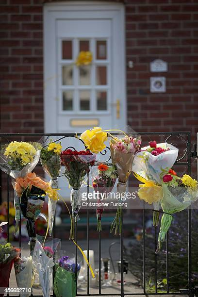 Floral tributes lay at the front door of murdered British aid worker Alan Henning on October 5 2014 in Salford England Residents and friends are...