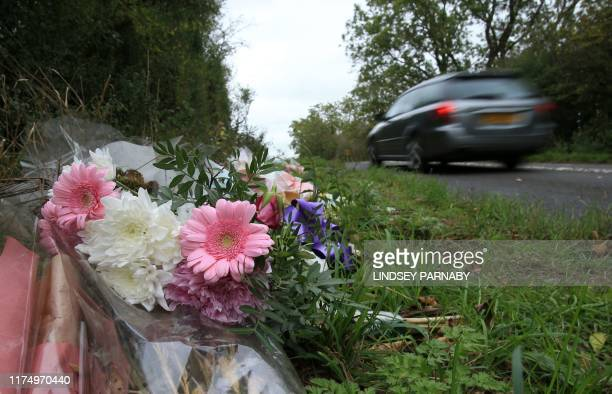 Floral tributes lay on the roadside near RAF Croughton in Northamptonshire central England on October 10 at the spot where British motorcyclist Harry...