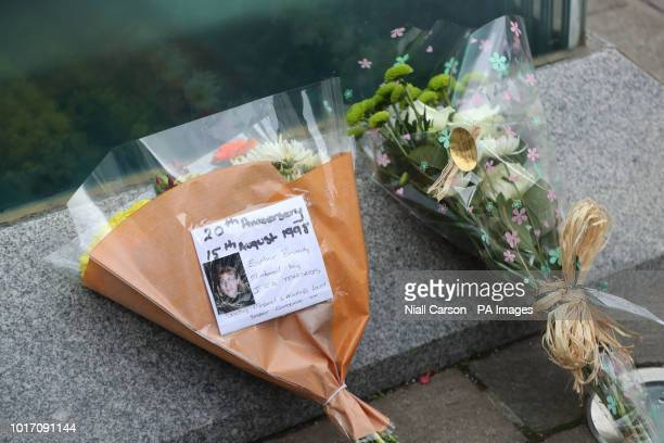 Floral tributes left at the Omagh Bomb Memorial located on Market Street ahead of the ceremony to mark the 20th anniversary of the Omagh bombing on...