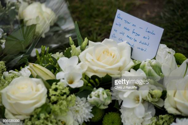Floral tributes left by the Mayor of London Sadiq Khan in Parliament Square on the first anniversary of the Westminster Bridge terror attack on March...