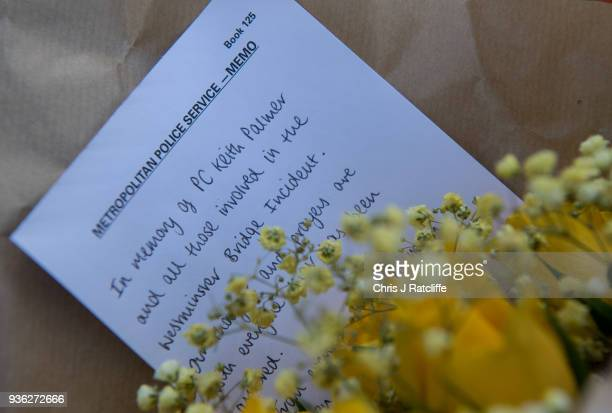 Floral tributes left by the Metropolitan Police in Parliament Square on the first anniversary of the Westminster Bridge terror attack on March 22...