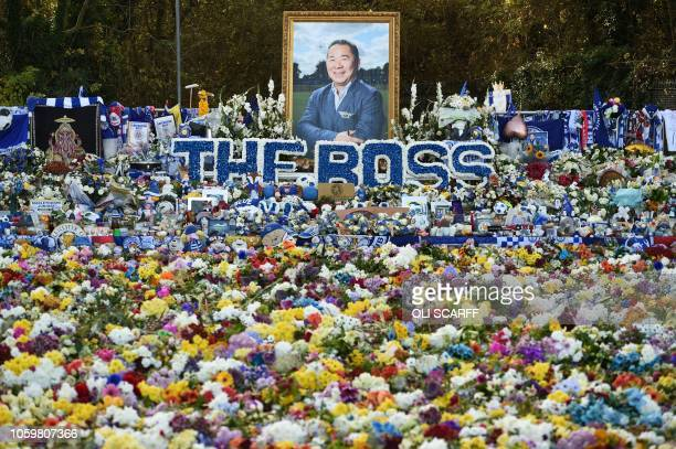TOPSHOT Floral tributes left for Leicester City's late owner Vichai Srivaddhanaprabh are pictured ahead of the club's English Premier League football...