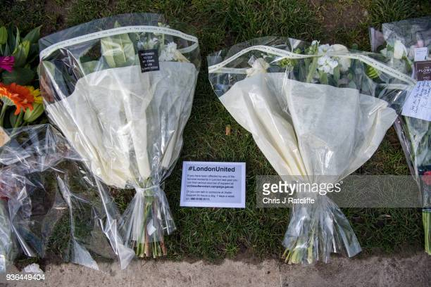 Floral tributes left in Parliament Square on the first anniversary of the Westminster Bridge terror attack on March 22 2018 in London England On...