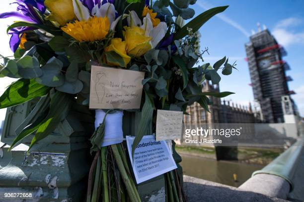 Floral tributes left on Westminster Bridge on the first anniversary of the Westminster Bridge terror attack on March 22 2018 in London England On...
