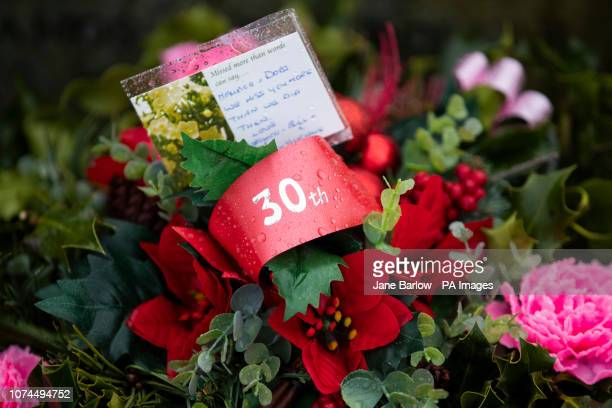 Floral tributes left to mark the 30th anniversary of the Lockerbie bombing at the Memorial Garden Dryfesdale Cemetery Lockerbie