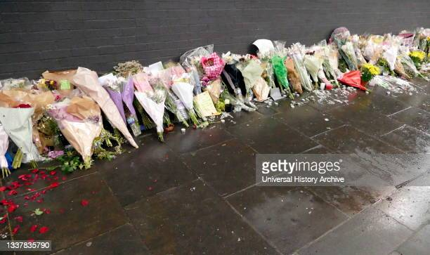 Floral tributes marking the Grenfell Tower fire in London. The fire occurred on 14 June 2017. At the 24-storey Grenfell Tower block of public housing...